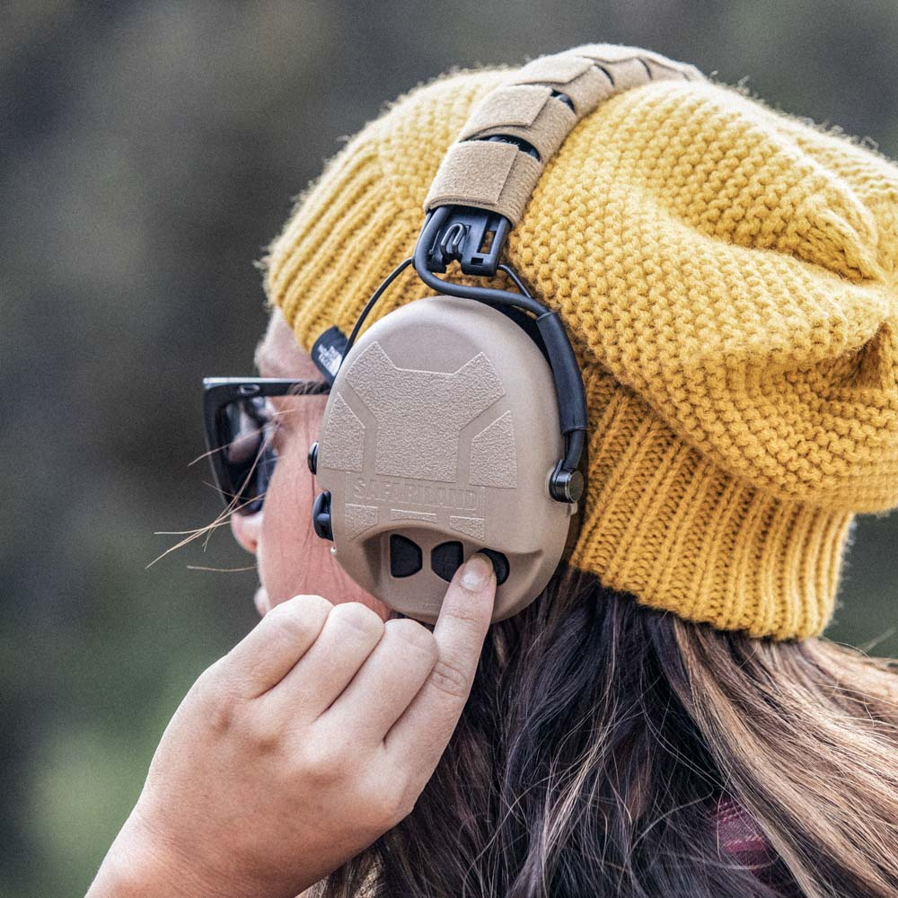 Girl wearing Safariland Liberator HP hearing protection