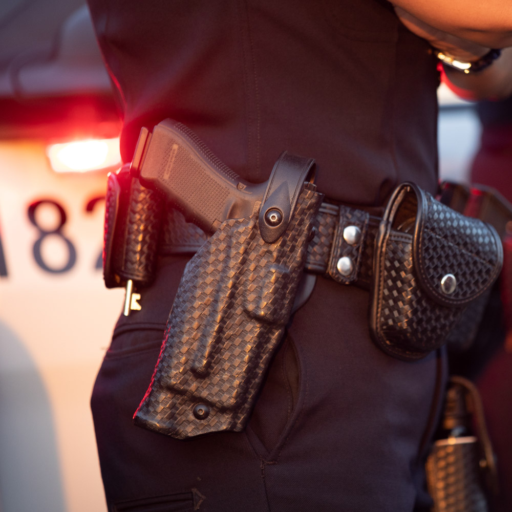 Police Officer wearing a Safariland® duty holster