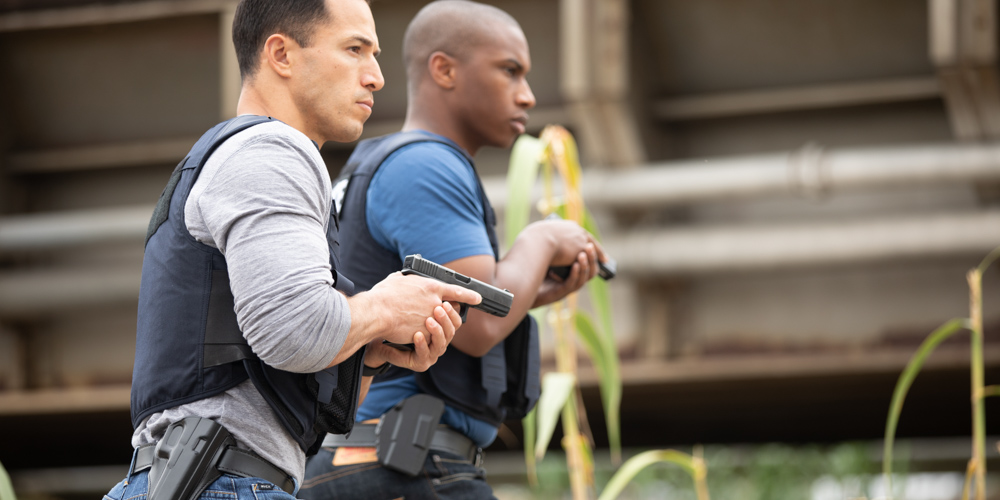 Detectives wearing Safariland® and Bianchi® concelable holsters.