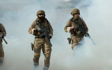 Military Operators walking through smoke