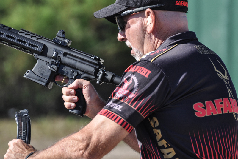 Scott Carnahan from Team Safariland reloading during competition