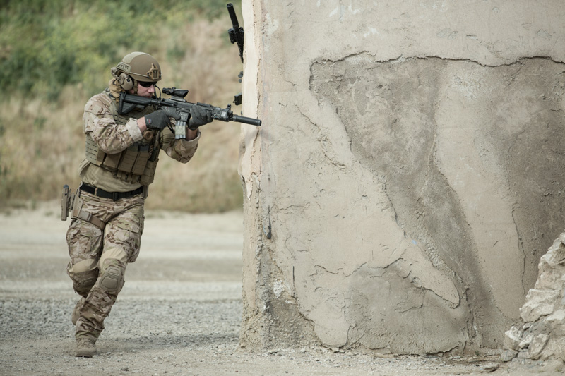 Tactical/Military Operator wearing Safariland® armor and gear running outdoors.