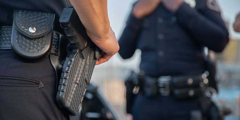 Police officers wearing Safariland® duty holsters