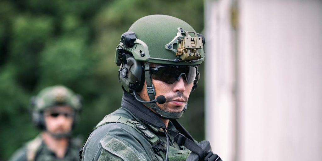 Tactical operator wearing a PROTECH Tactical® helmet with Safariland®/TCI™ Liberator™ headset
